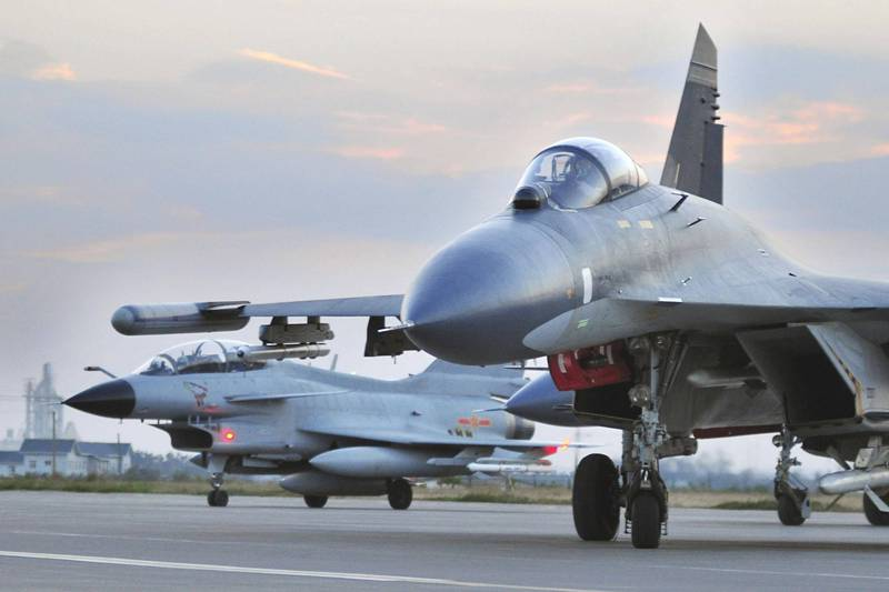 China warns foreign planes entering defense zone